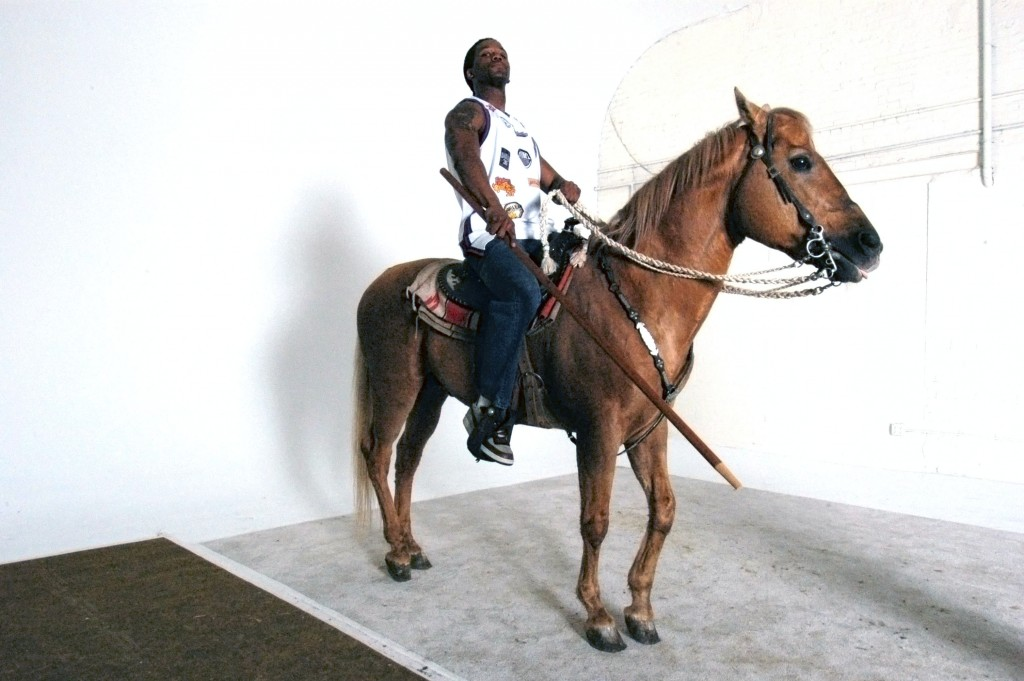 model posing for Rumors of War series with a horse, 2005. © Kehinde Wiley.