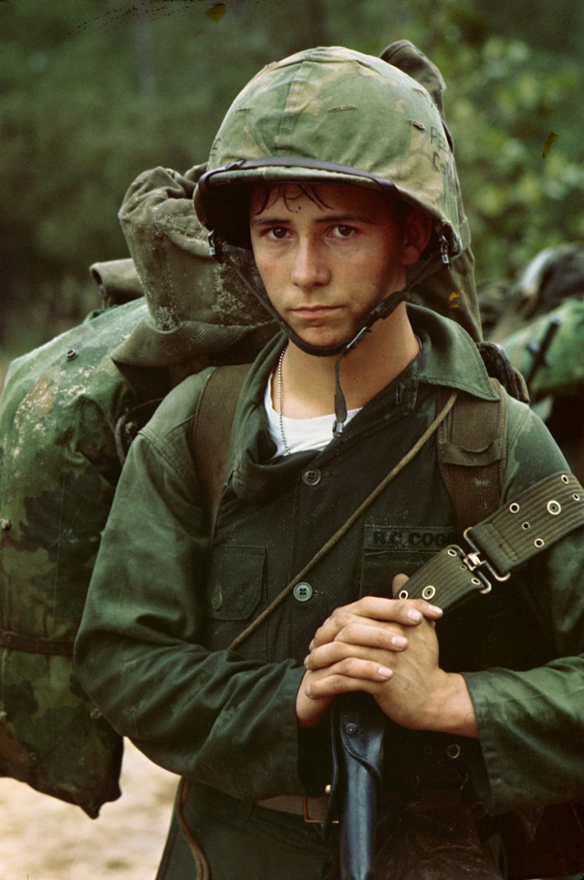 A young Marine private waits on the beach during the Marine landing, 1965, Da Nang, Vietnam, By an unknown photographer, August 3, 1965, courtesy of the National Archives and Records Administration, Records of the U.S. Marine Corps.